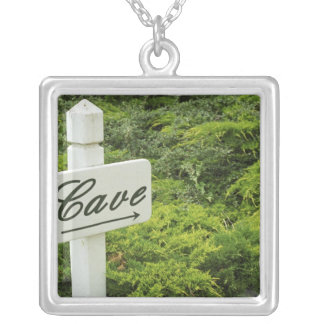 A sign pointing tho the wine cellar (Cave) in Square Pendant Necklace