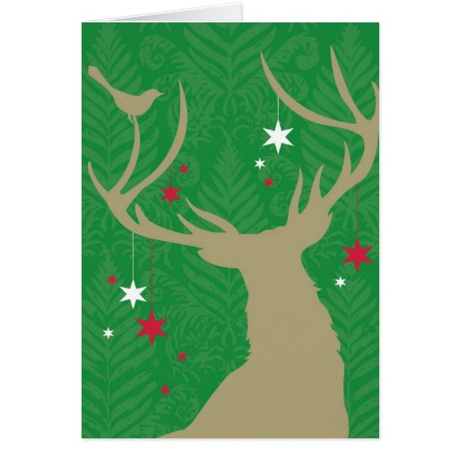 A silhouette of a deer with stars hanging from its greeting cards