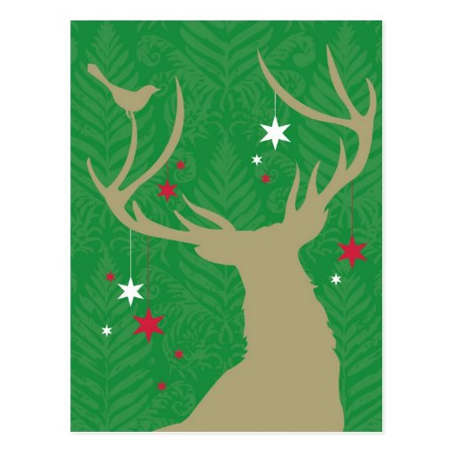 A silhouette of a deer with stars hanging from its post card