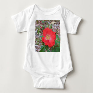 A simple salmon colored open rose baby bodysuit