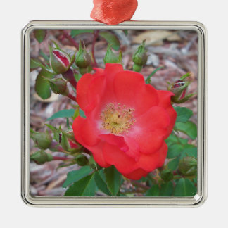 A simple salmon colored open rose metal ornament