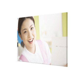 A smiling childminder canvas print