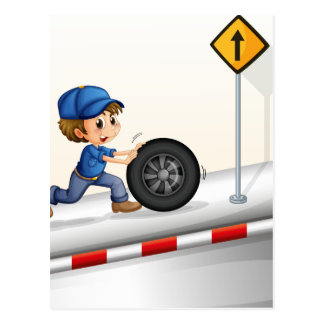 A smiling mechanic pushing the tire postcard