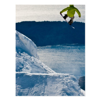 A snowboarder jumping postcard