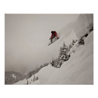 A snowboarder jumps off a cliff into powder in poster