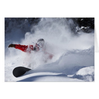 A snowboarder rips untracked powder turns in greeting card
