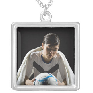 A soccer player 7 silver plated necklace