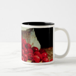 A spilled bag of cherries coffee mugs