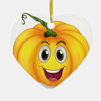 A strong squash with a smiling face ceramic heart ornament