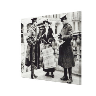 A Suffragette selling newspapers to two Stretched Canvas Print