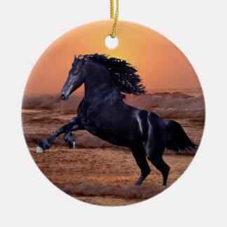 A sunset ocean horse christmas tree ornament