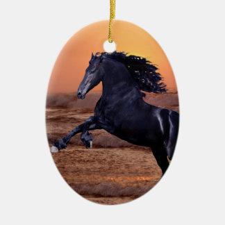 A sunset ocean horse ornament