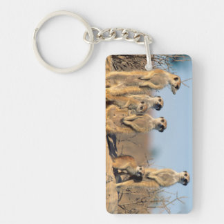 A Suricate family sunning themselves at their den Key Ring