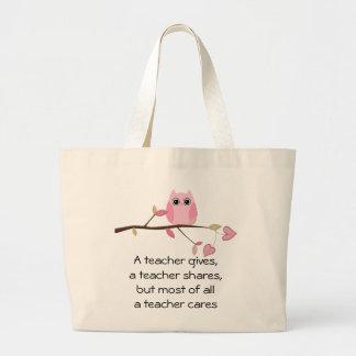 A teacher cares large tote bag