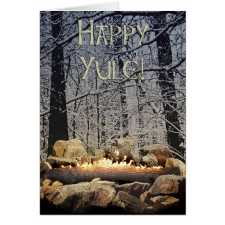 A Tranquil Burning Yule Log in a Snowy Forest Card