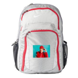 a trekker  with his binoculars on Nike Backpack
