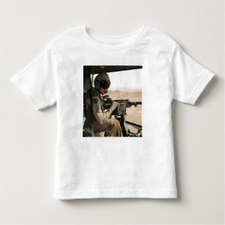 A UH-1N Huey crew chief scans the ground Toddler T-Shirt