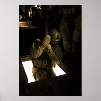 A US Air Force pararescueman begins his descent Poster