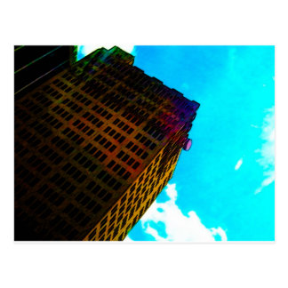 A vibrant and tall building against the  blue sky postcard