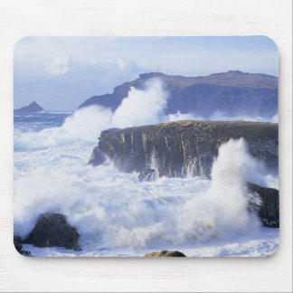 a view of the waves crashing against rocks mouse pad