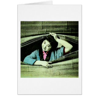 A Vintage Japanese Geisha Peeking Through a Blind Card
