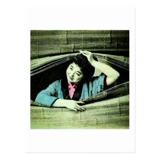 A Vintage Japanese Geisha Peeking Through a Blind Postcard