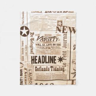 A vintage old news paper print typography fleece blanket