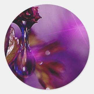 A water drop in purple classic round sticker