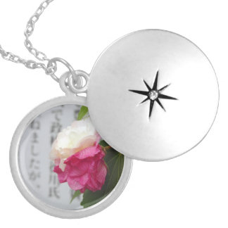 A white, a pink flower and Japanese characters Pendant