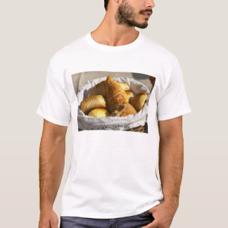 A wicker breakfast basket with croissants, and T-Shirt