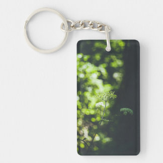 A wild flower in the green nature key ring