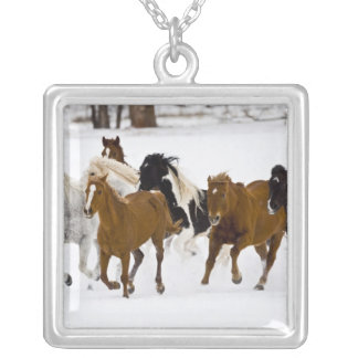 A winter scenic of running horses on The Square Pendant Necklace
