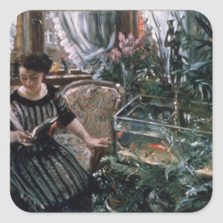 A Woman Reading near a Goldfish Tank Square Sticker