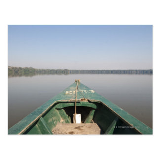 A wooden canoe made of Eucalyptus tree floats in Postcard