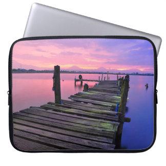 A wooden pier laptop sleeve