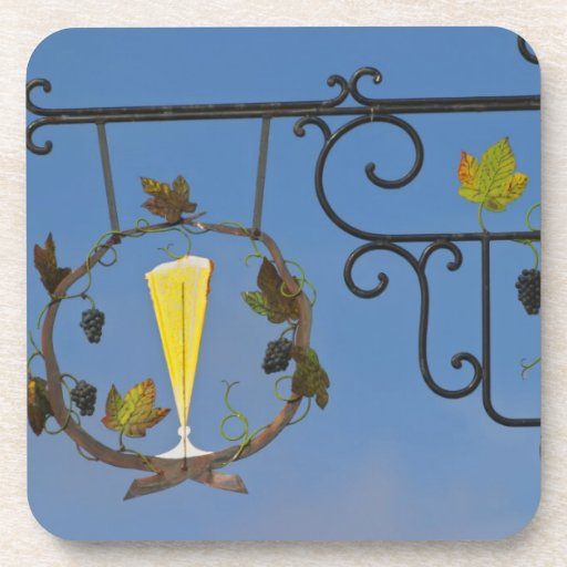 A wrought iron sign that illustrates the theme beverage coaster