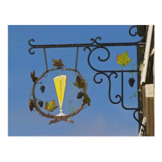 A wrought iron sign that illustrates the theme postcard