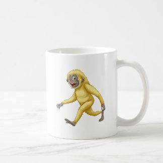A yellow gorilla basic white mug