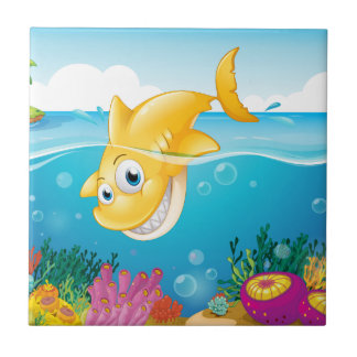 A yellow shark diving into the sea ceramic tile