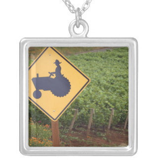A yellow tractor crossing sign in the vineyard square pendant necklace
