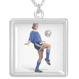 a young blonde caucasian female in a blue soccer silver plated necklace