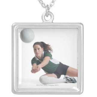 a young caucasian female volleyball player in a silver plated necklace