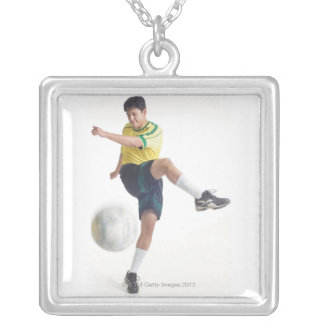 a young latin male wears a yellow soccer jersey silver plated necklace