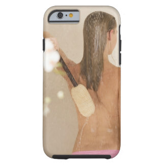 A young woman in a shower tough iPhone 6 case