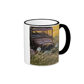 Abandoned old car in tall grass ringer mug