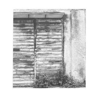Abandoned shop forgotten bw notepad
