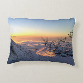 Above clouds in the snowy mountain decorative cushion