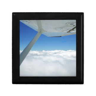 Above the clouds small square gift box