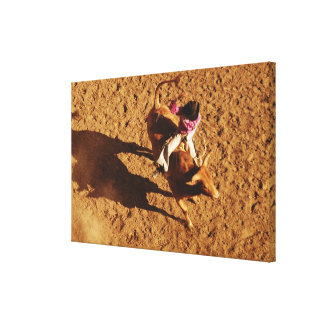 Above View of a Cowboy Riding a Bull Canvas Print