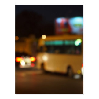 Abstract and blur night scene with bus and headlig postcard